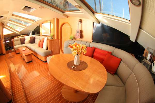 Port aft suite with queen-sized bed, spacious sette, and vanity.